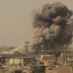 FILE PHOTO: Smoke rises after an air strike during fighting between members of the Syrian Democratic Forces and Islamic State militants in Raqqa